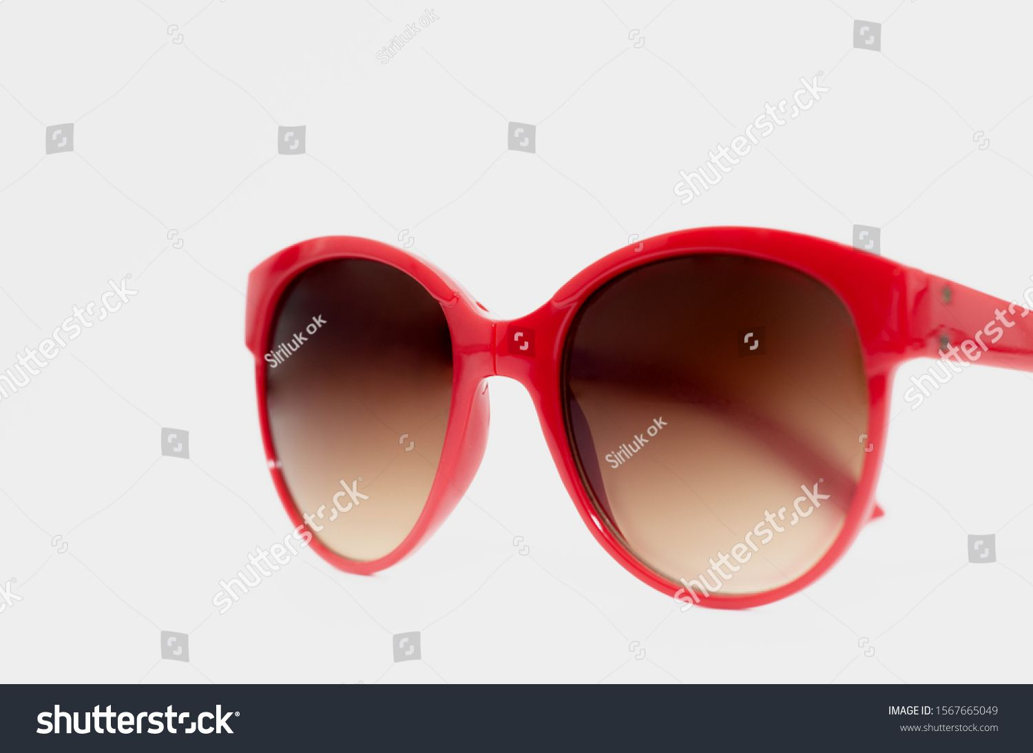 Red sunglasses isolated on a white backgroundCopy space