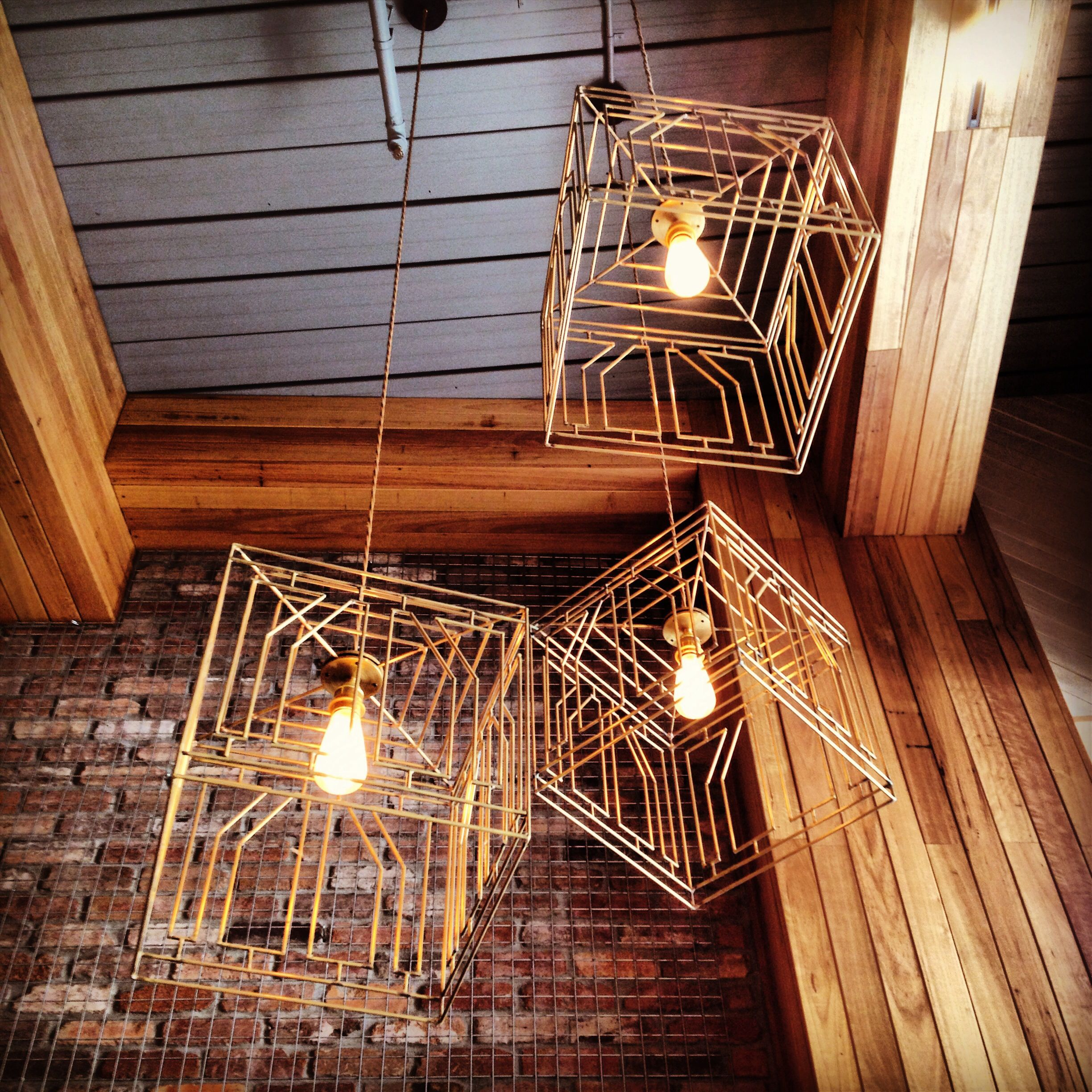 brass pendant lights suspended in pablo & rusty's cafe