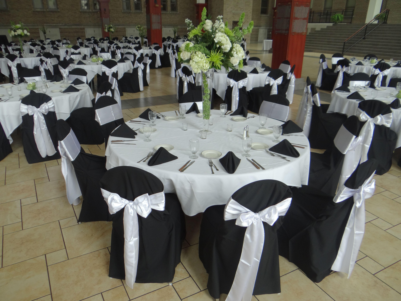 white tablecloths black runner black napkins black chair covers