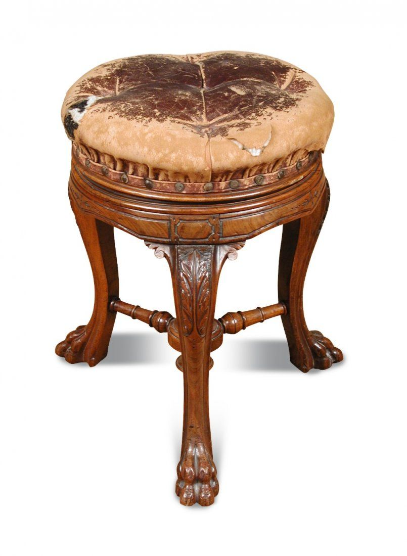 3:00 AM - Sep 18. Lot 997.  A mid Victorian carved walnut piano stool. Estimate £150 – £250. A mid Victorian carved walnut piano stool, with buttoned leather revolving seat, stamped HOWE to the mechanism and stamped 4928 17136 to the frame
