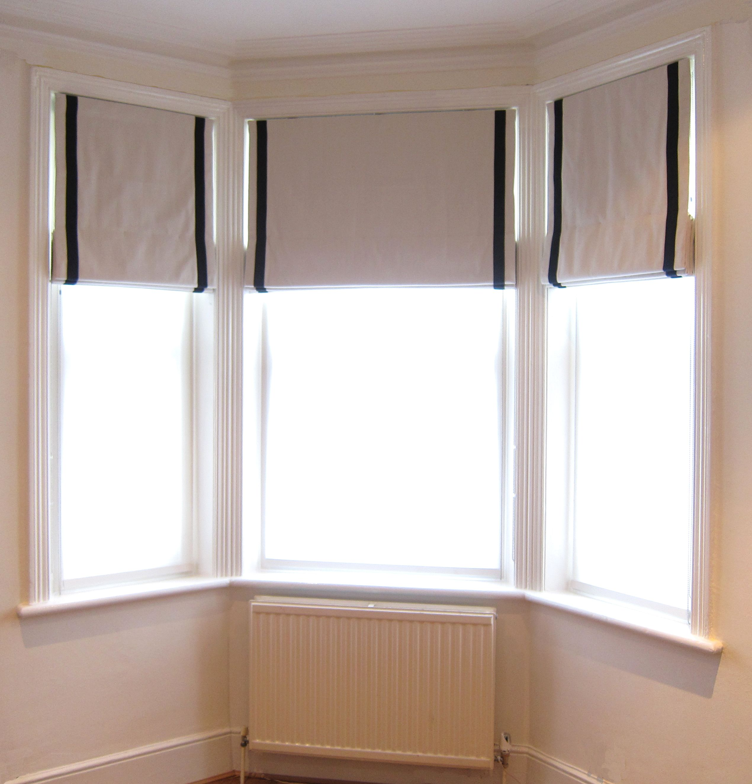 Bay Window With Roman Blinds With A Contrast Inset Border