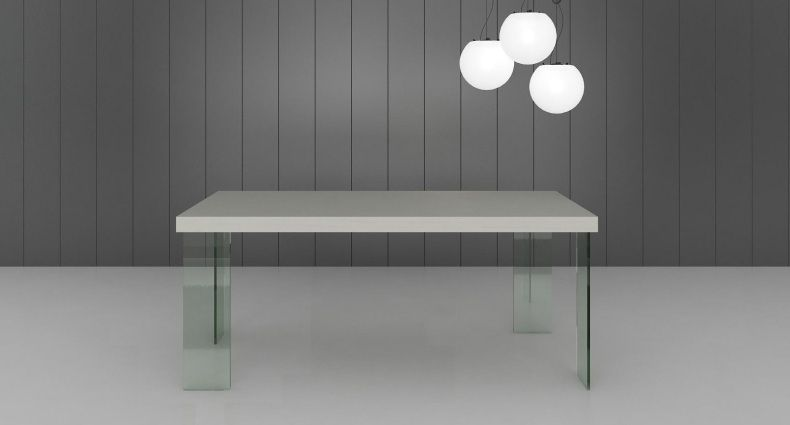 The Calanna White Gloss And Glass Dining Table Has A Funky White