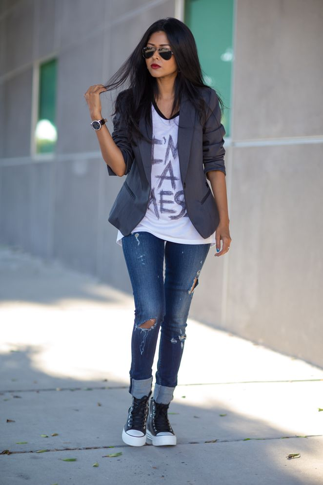 High tops with rolled up distressed jeans. Cool long tee with gray blazer