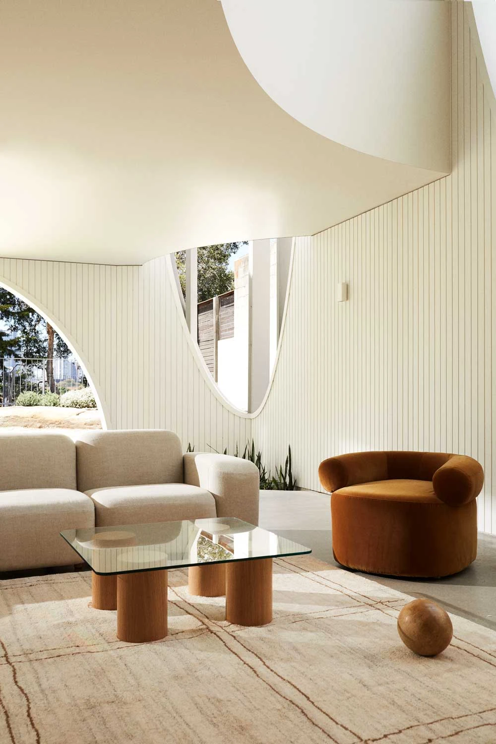 SOL is a minimalist furniture collection created by Australia-based designer Sarah Ellison. The collection, which includes sofas, lounge chairs, tables, and shelving, focus mainly on sculptural forms with warm materials and colors. The pieces were inspired by vintage 1970s designs, heavily playing on proportions and scale. Most notable is the Muse sofa, which emphasizes on substantially rounded features with a focus on comfort.