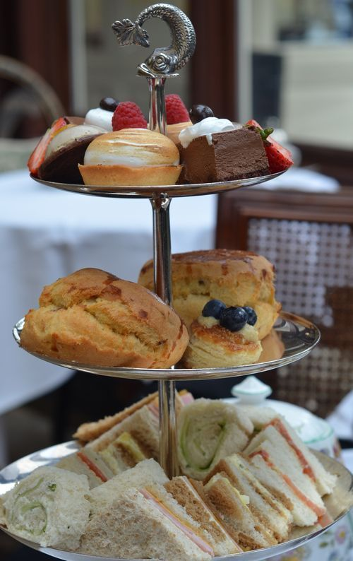 AFTERNOON TEA - in the proper order of tea sandwiches for the first course on the bottom tier.  Scones with cream and jam for the second course on the middle tier.   On the top tier are the sweets for the last course. #food #recipes