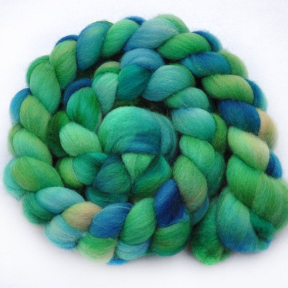 colors of the sea.  what a wonderful shawl this would make.  http://www.etsy.com/listing/88963888/handpainted-roving-sea-spray-portuguese
