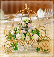 simple Disney centerpieces -- I like the pumpkin carriage but not the floral choice