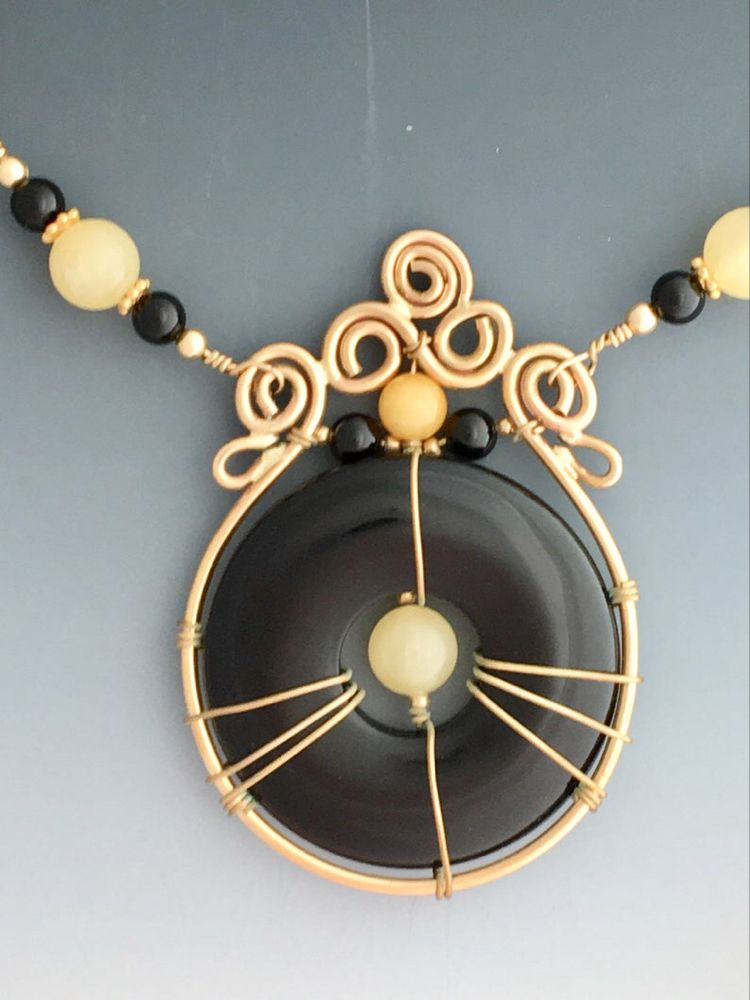 Best Black Onyx Donut Wire Wrapped With Yellow Gold Filled Wire 400 x 300