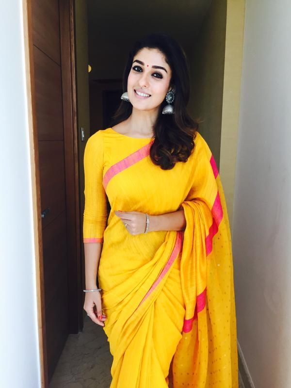 d863a14e3 Nayanthara at the opening of Salem Kalyan Silks in a Yellow raw silk saree  with contrast pink borders paired with 3/4 sleeves boat neck blouse