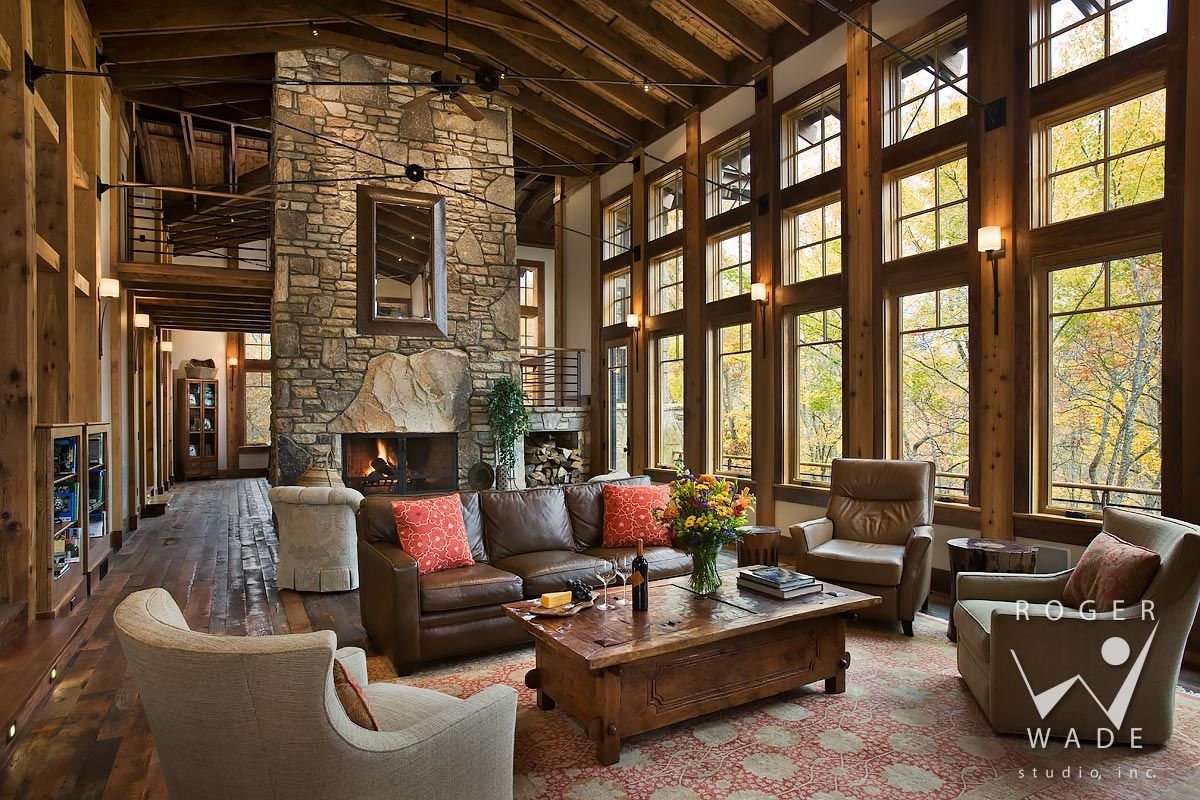 living room toward fireplace and windows looking out to fall color ...