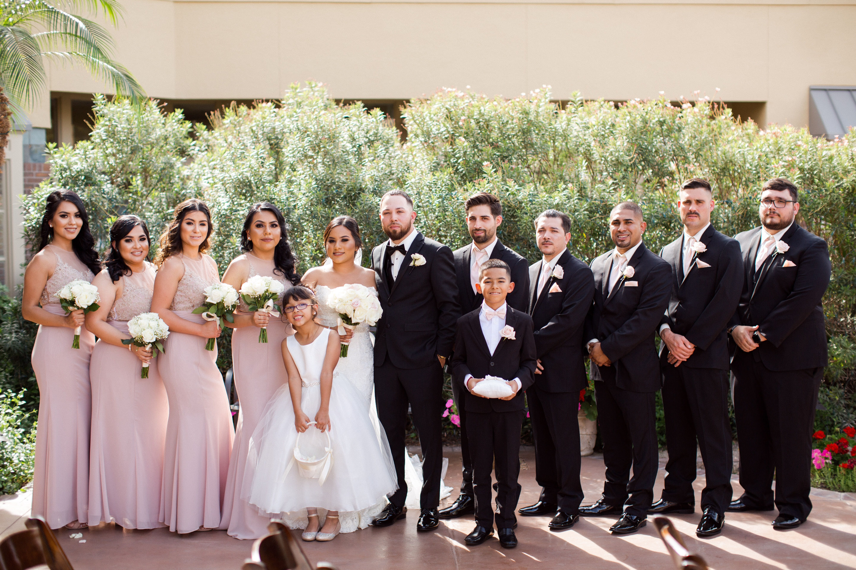 Bridesmaids wearing mauve and groomsmen