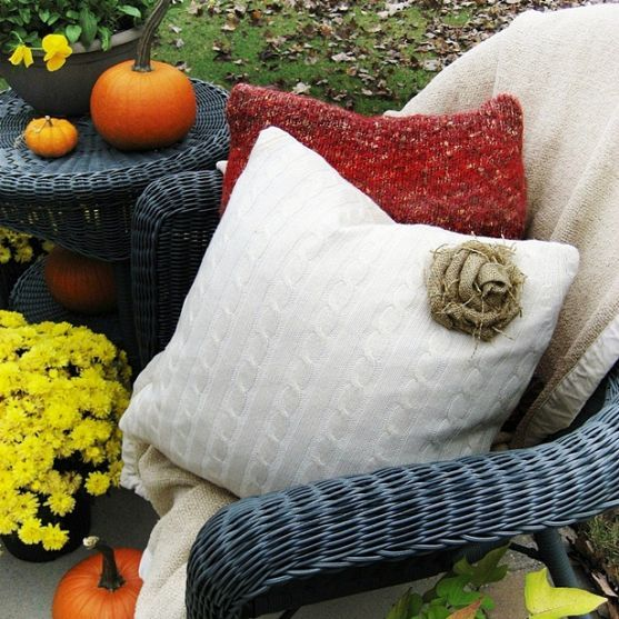 .Easy and inexpensive to make...sweater pillow with a burlap rose