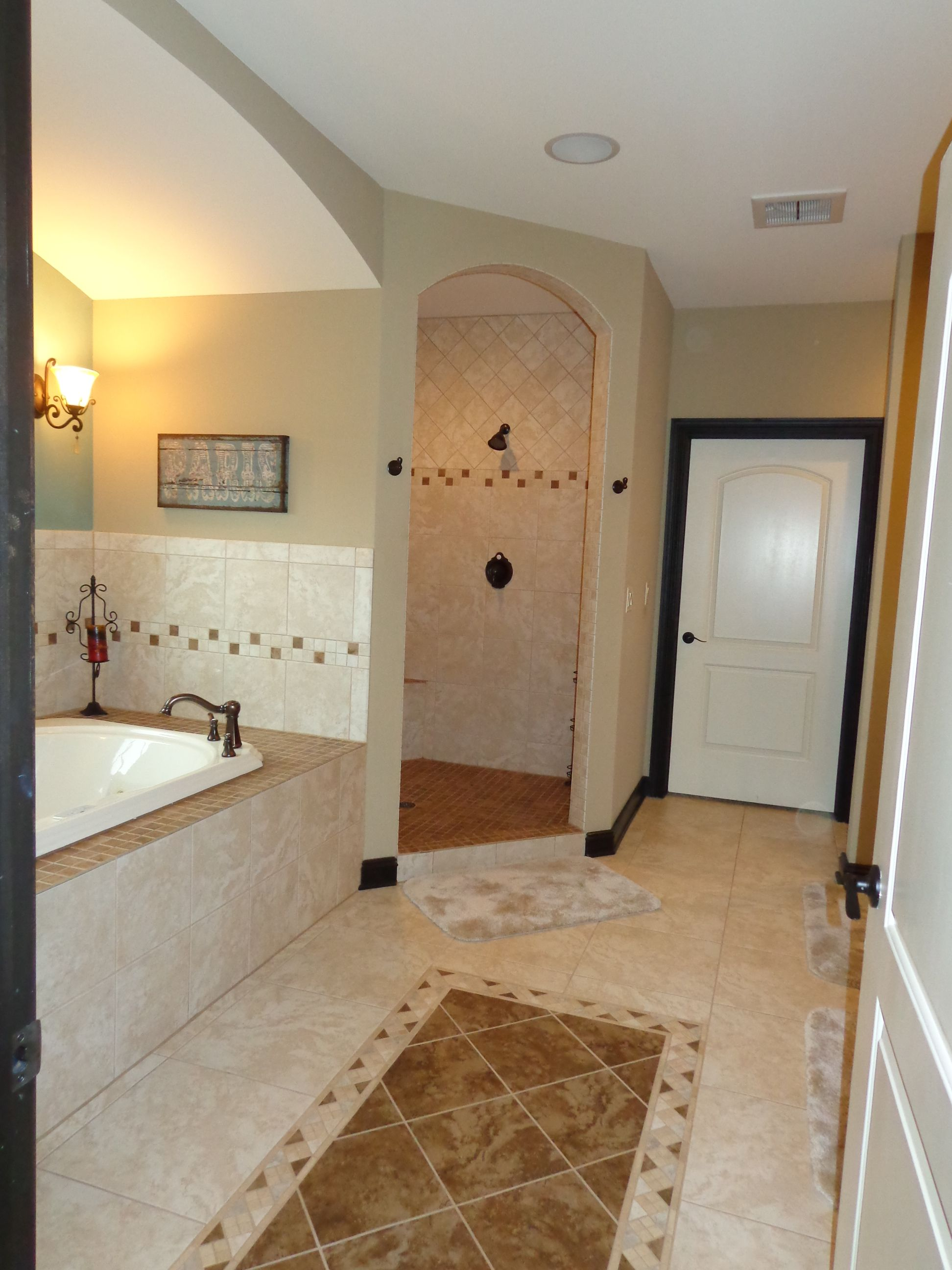 Master bathroom walk in double shower with no glass to for Bathroom door ideas