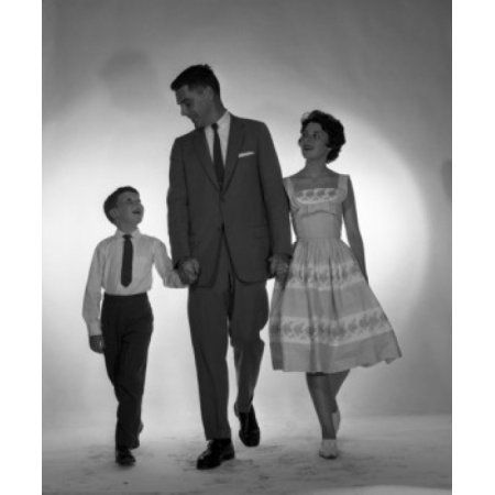 Portrait of family with one son walking arm in arm Canvas Art - (18 x 24)