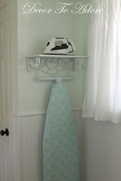 A Pretty Storage Solution for an Iron and Ironing Board #storagesolutions