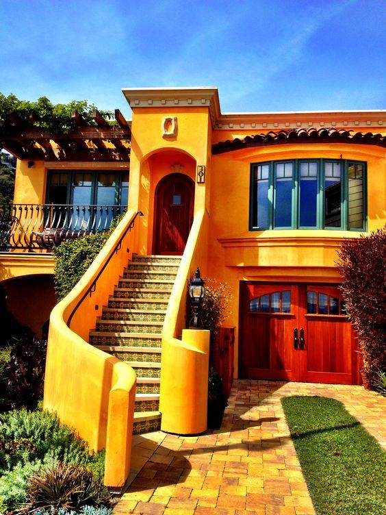 spanish style house stucco flat roof yellow with green accents rh pinterest com