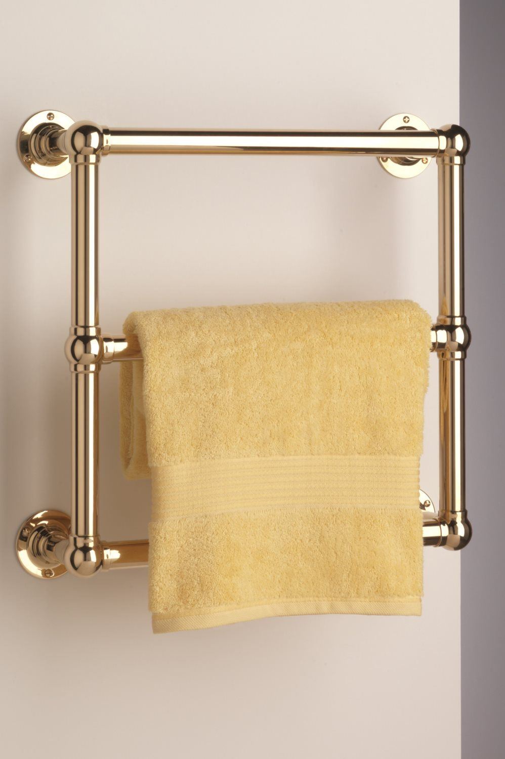 Wall Mounted Low energy Electric Heated Towel Rail. Shown in brass ...