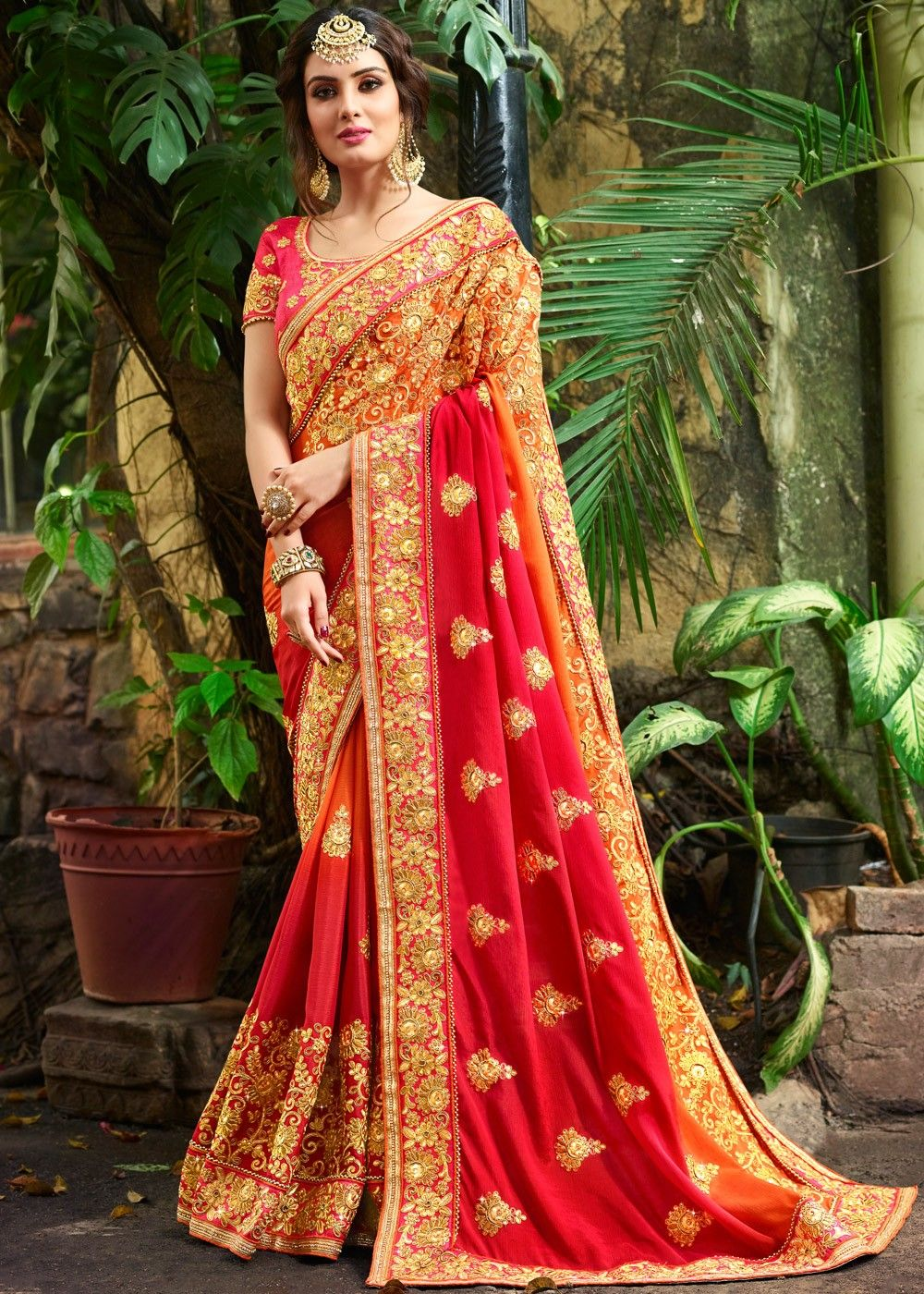 36dc3699290d6e #Orange shaded #crape #saree with richly embellished border work and motifs  in #zari work , resham #embroidery, stones & beaded details.