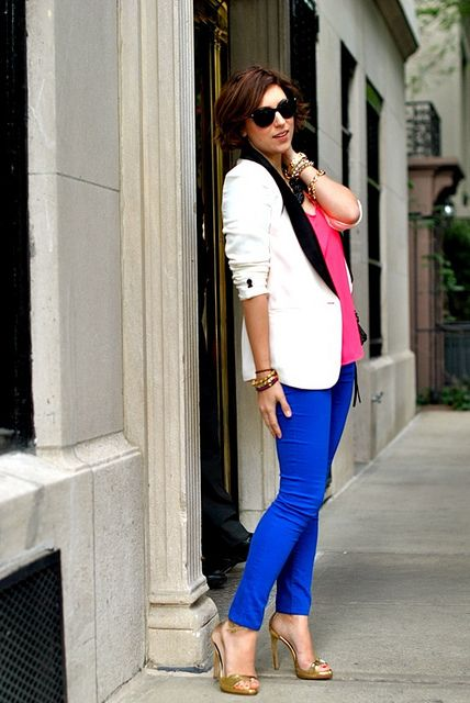 We adore Christine's chic yet casual look here! This white tuxedo style blazer looks really cool paired over these cobalt pants and hot pink top.