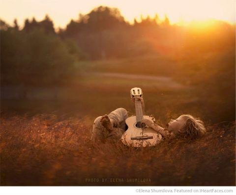 Boy playing guitar at sunset - Photo by Elena Shumilova - I Heart Faces Photographer Spotlight Series