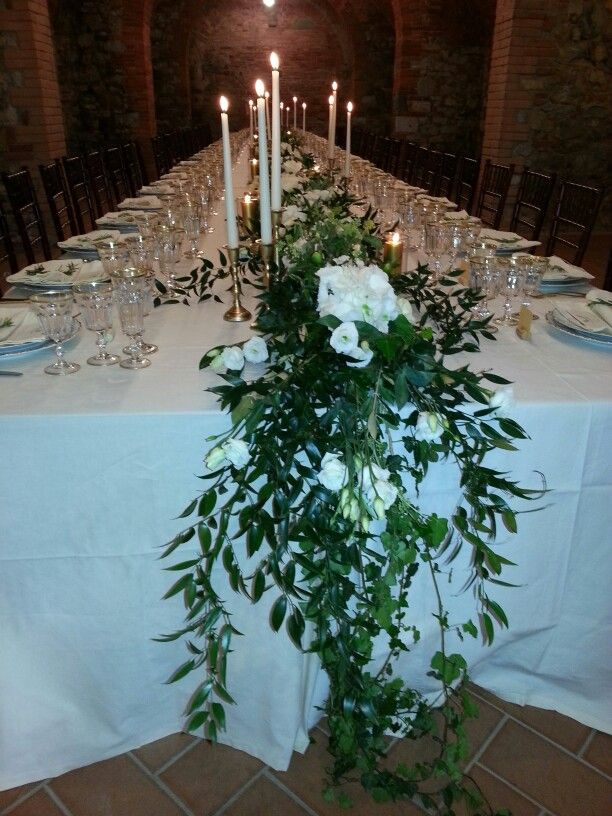 Tuscan table with olive branch and white flowers runner