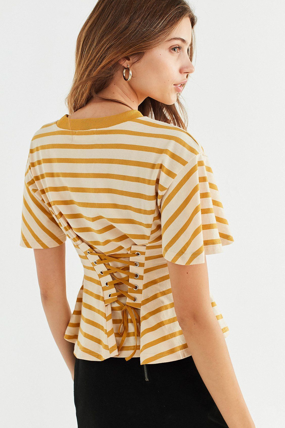 c1789fd87202 Shop UO Millie Lace-Up Corset Tee at Urban Outfitters today. We carry all  the latest styles