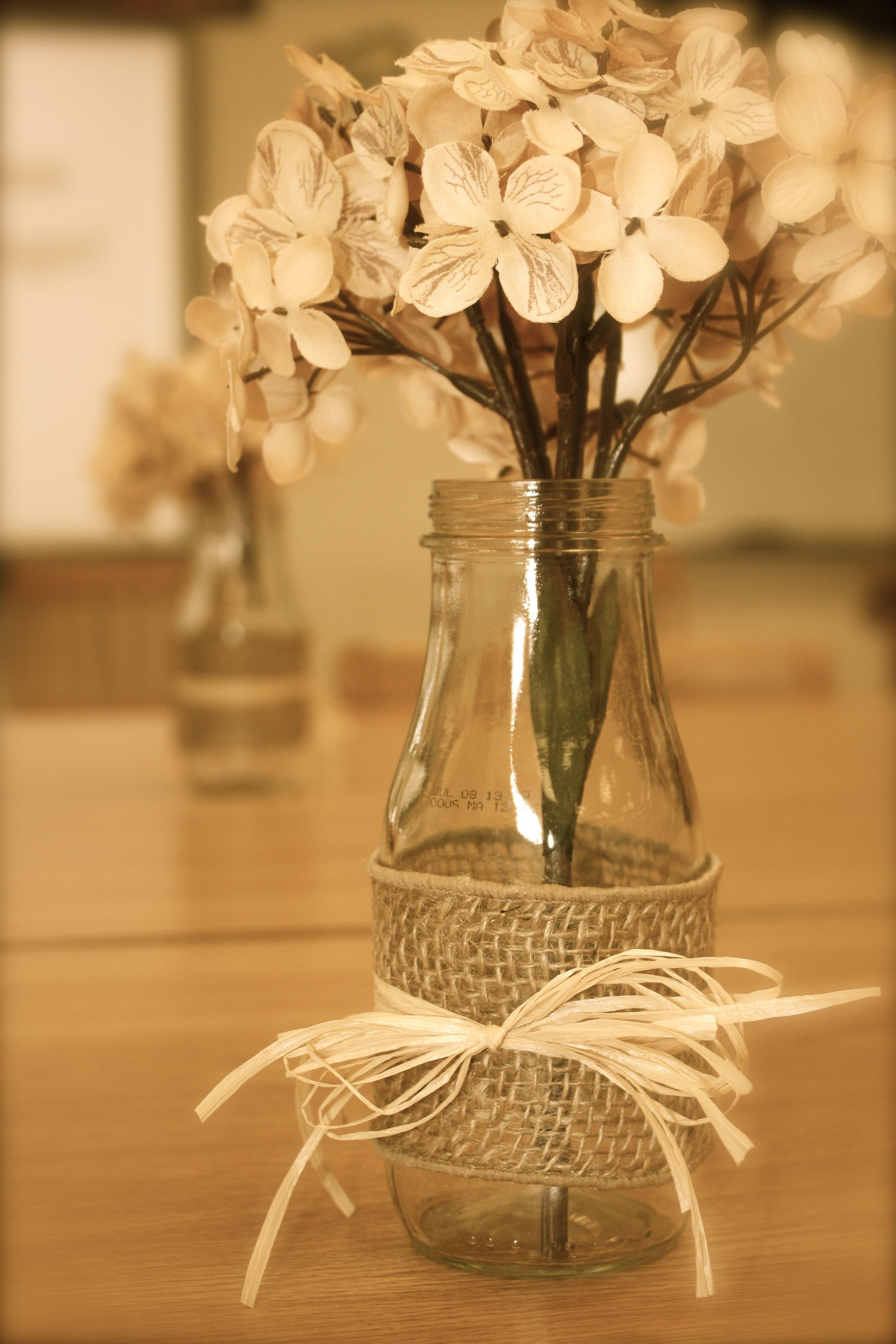 Table decorations made from starbucks frappucino bottles burlap and