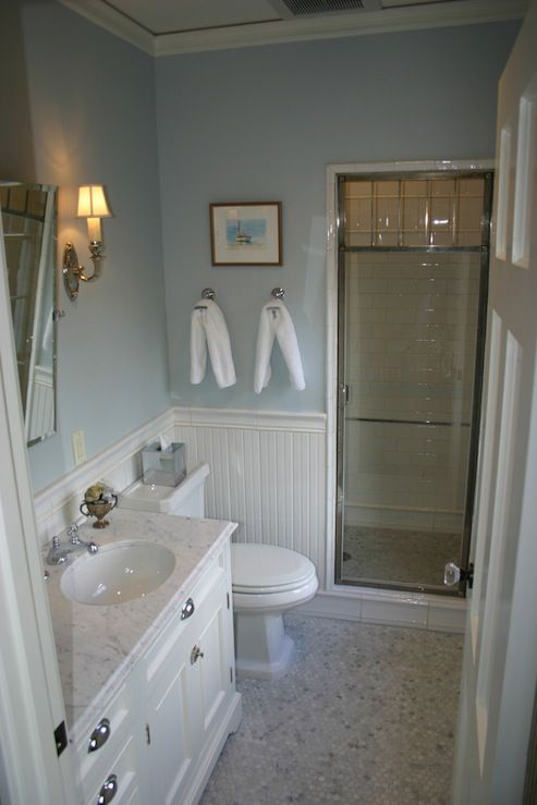 chic cottage beachy bathroom design with blue walls paint color chair rail with beadboard