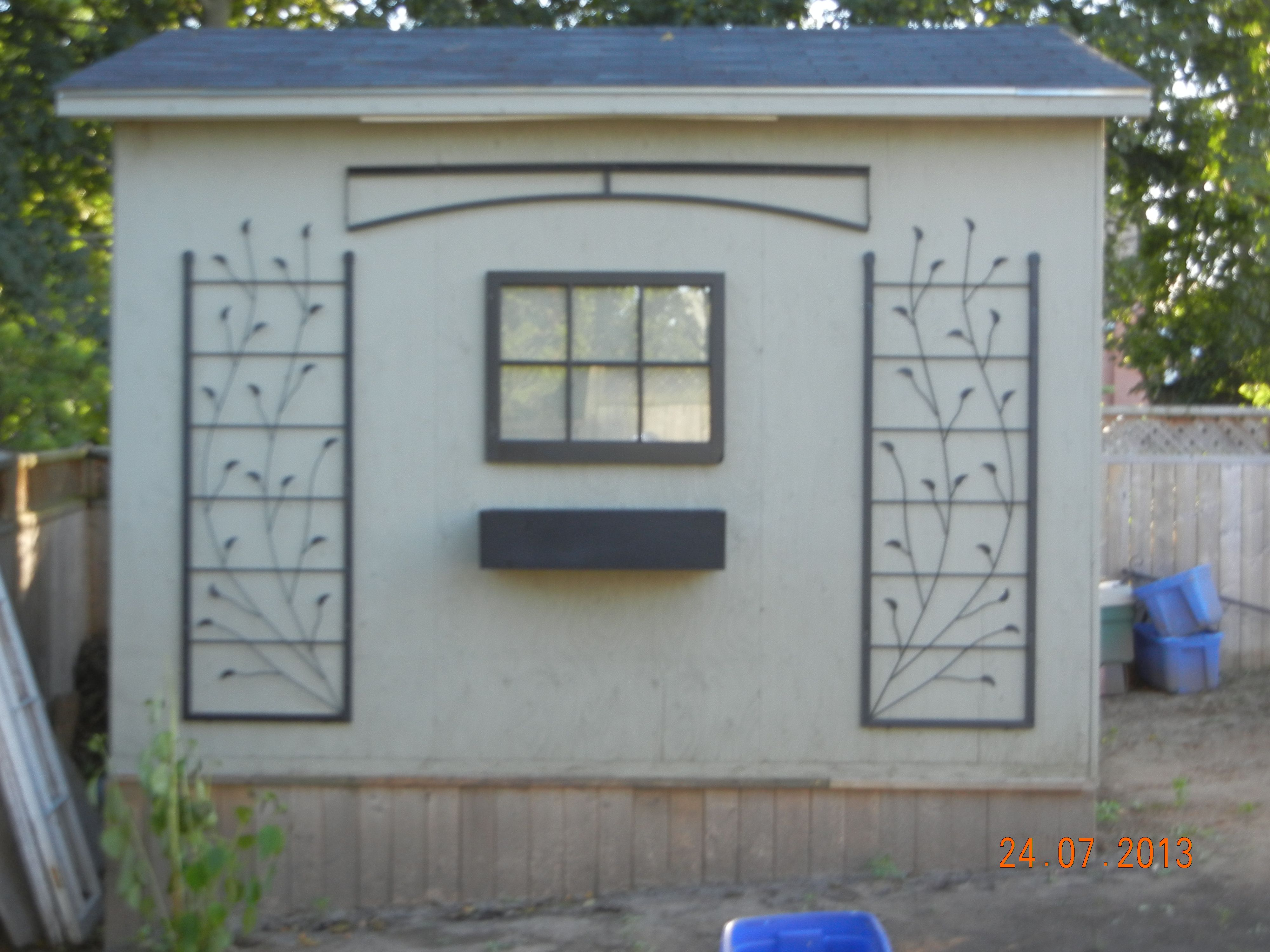 Kitchen back alley decor...one blank shed wall, an old and broken ...