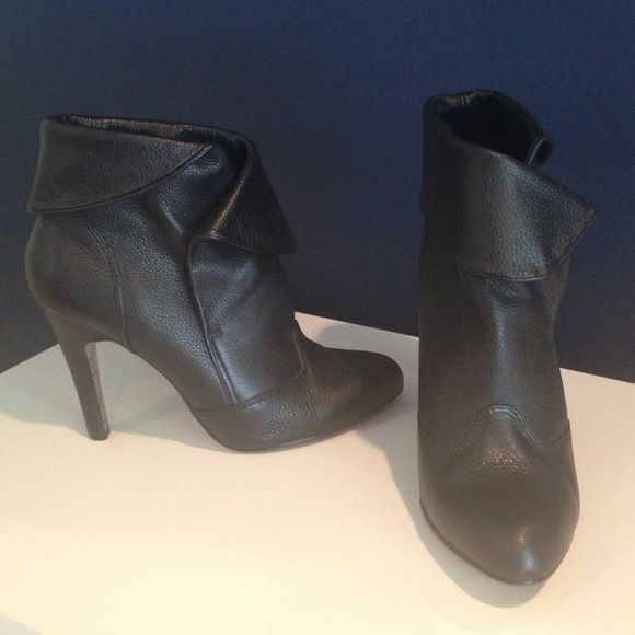 Report black booties Black leather booties by Report. Real leather. 3.5 inch heels. One heel is a little scuffed as seen in pic Report Shoes Ankle Boots & Booties
