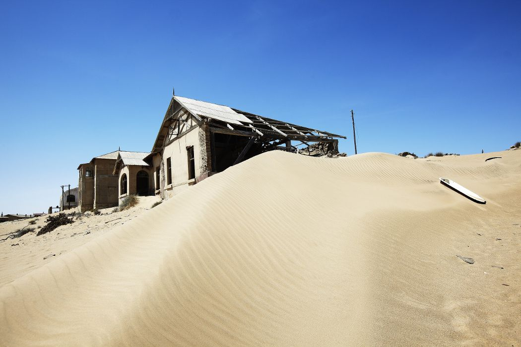Derelict buildings in diamond mining ghost town, NAMIBIA.
