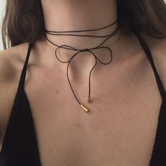 """Genuine Leather Bolo Tie Wrap Choker Necklace Thin wrap choker bolo necklace made from genuine 1mm leather cord and adorned with gold come ends! Choker measures 54"""" in length. Can be worn so many different ways - wrapped, tied, bowed. Not Free People, but similar style to FP, Brandy Melville, Nasty Gal, and For Love and Lemons. Buy from my Etsy shop (MoonluxDesigns) for a cheaper price and shipping rate! (Link in bio). Free People Jewelry Necklaces"""