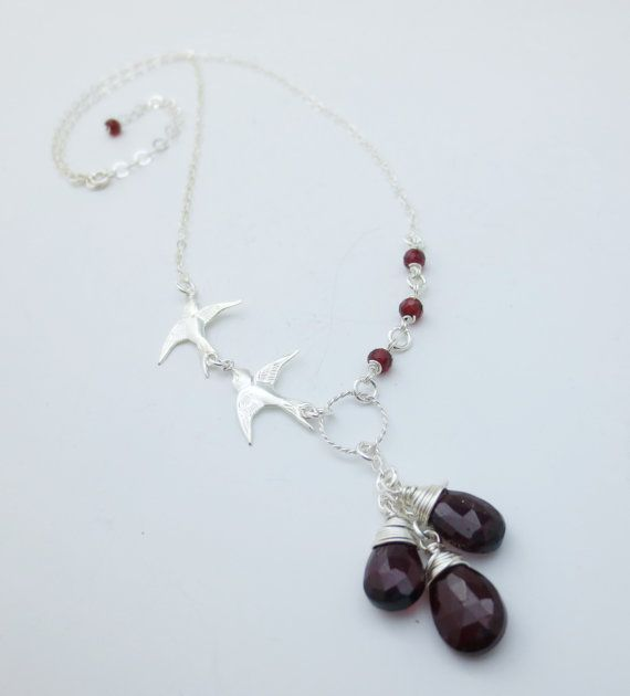 Delicate necklace features your choice of gemstone (garnet, peridot, or amethyst) carefully handwrapped in fine sterling silver and paired with