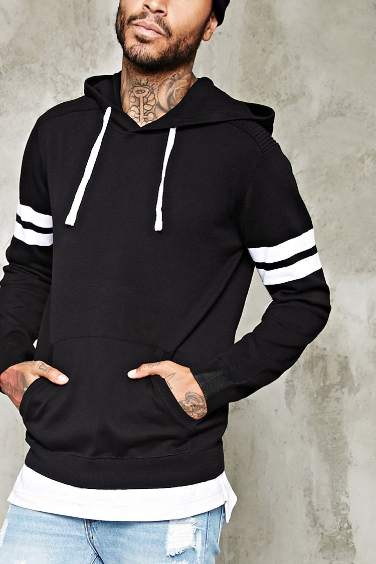 A lightweight sweater with a drawstring hood, ribbed panels along ...