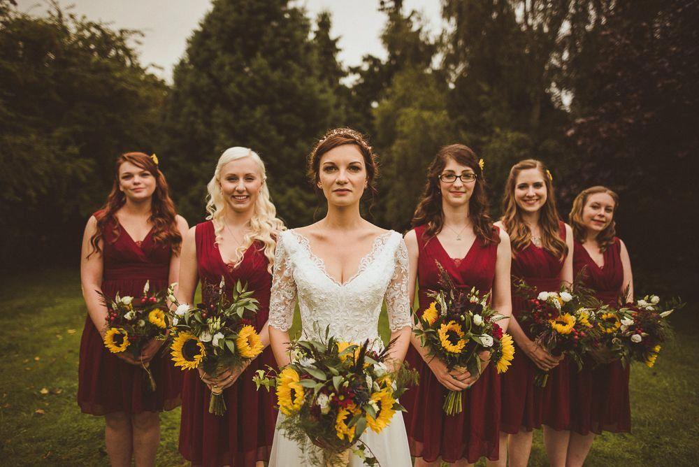 Red Bridesmaids Dresses Sunflower Bouquets Weddingideas Sunflower Themed Wedding Sunflower Wedding Bouquet Red Bouquet Wedding
