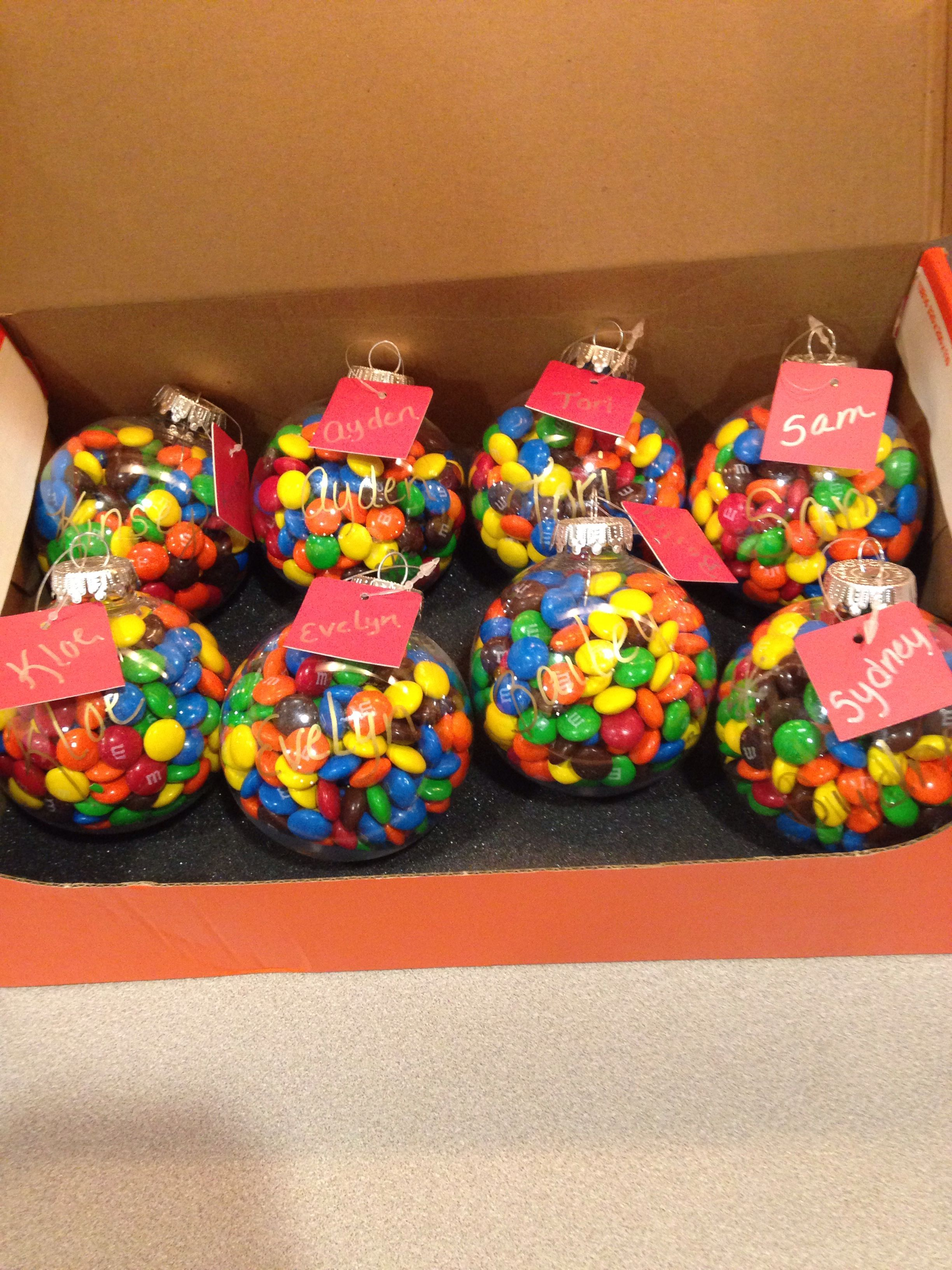 Little Christmas gift for friends cheep plastic Christmas bulb some m&m's and name tags http://www.giftideascorner.com/gifts-coworkers/