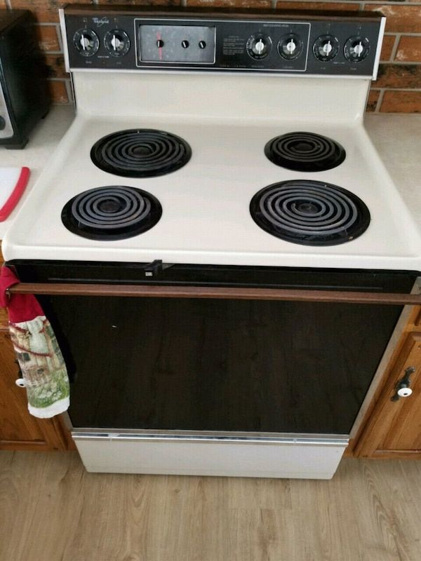 Used white and black 4burner electric coil range oven for