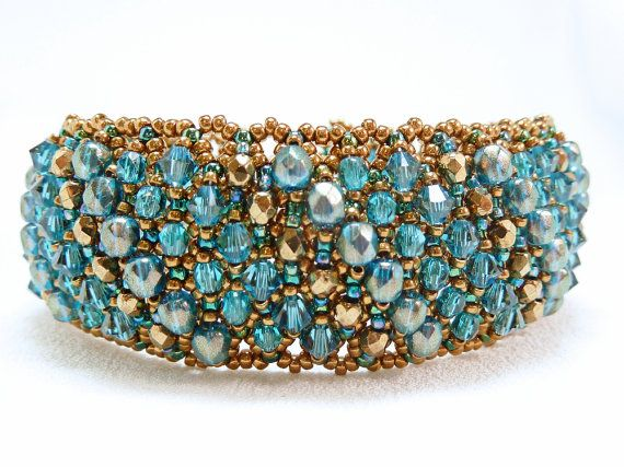 A stunning cuff bracelet woven of turquoise and bronze seed beads, embellished with Czech fire-polished beads and Swarovski crystals.  *** This is a made-to-order item. I do not have one in stock, I will make one to your specifications - just for you. Made-to-Order items generally ship about a week after the order is received but if I have an order backlog, it could be longer. If timing is an issue, please contact me to find out my current schedule. ***  To me, this bracelet looks like youd…