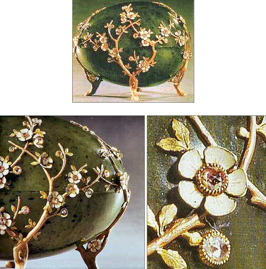 The 1901 Kelch Apple Blossom Egg: The Egg, a jewel case, is made from a solid piece of carved nephrite resting on 4 red and green gold feet fashioned as twisted branches which spread out over the egg as twigs with knots, veins and patches of moss bearing gold leaves and pink-foiled rose-cut diamonds set within pink and whiteenamelled petals. The surprise has been lost