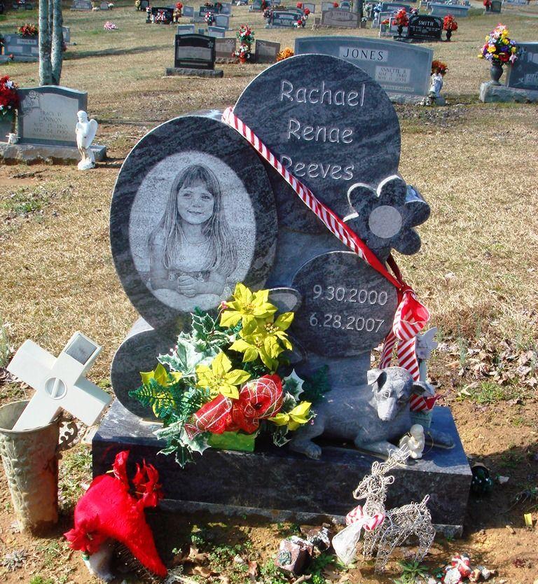 Reeves dog and flower carvings headstone in blue granite