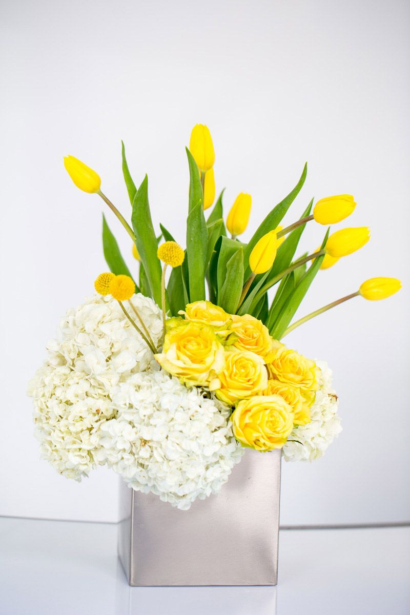 Centerpieces yellow roses hydrangeas tulips modern