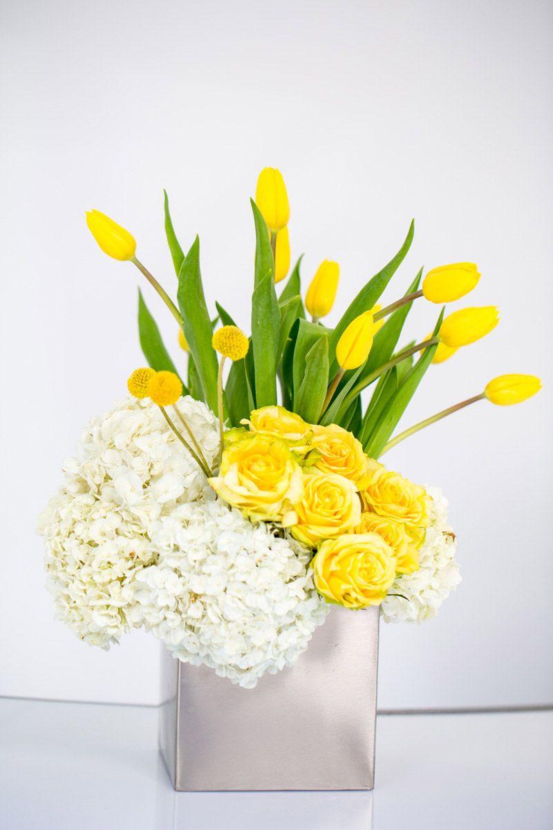 Centerpieces yellow roses hydrangeas tulips modern