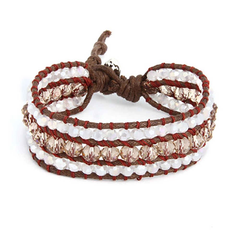 Add some sparkle to your everyday look in a cool and trendy way! This Chen Rai Cocoa and Quartz Leather Beaded Single Wrap Bracelet has three strands of glistening brown and quartz beads, held in line by thin lines of brown leather. The 8.5 inch wrap around bracelet has a simple, hammered-silver button closure, allowing you to adjust the size of the bracelet to fit your wrist perfectly. Shop with confidence and show off the latest style!