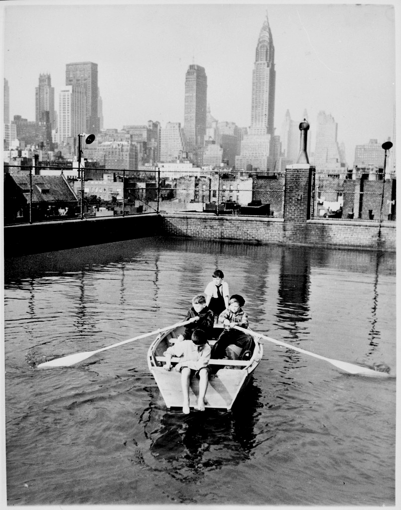 Madison Square Boy's Club rowing a boat in a rooftop pool