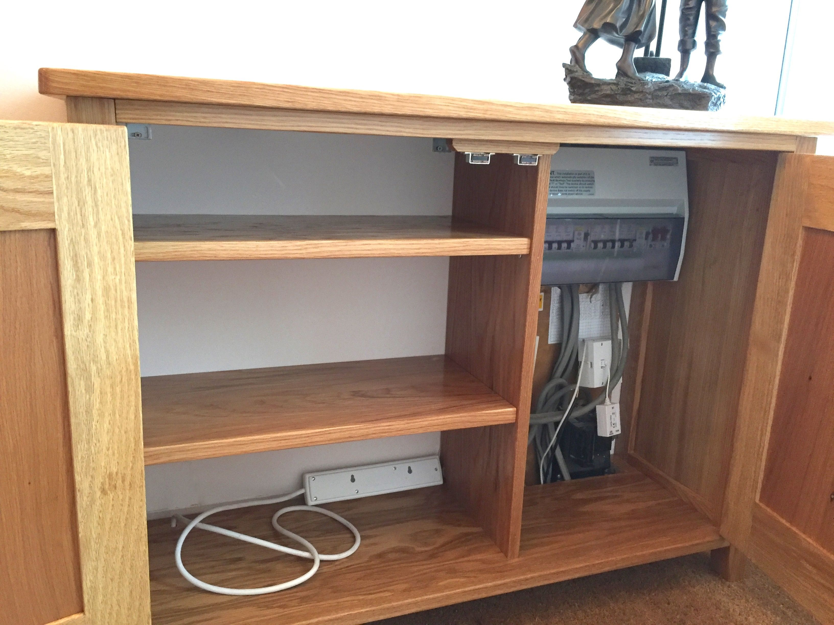 Unsightly electrical metre or fuse box and wondering what to do. Bespoke  Cabinets by furniture