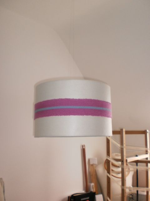 Large lampshade in cream wool felt and a pink and baby blue trimming. 1 available. Grainne Kenny Design.