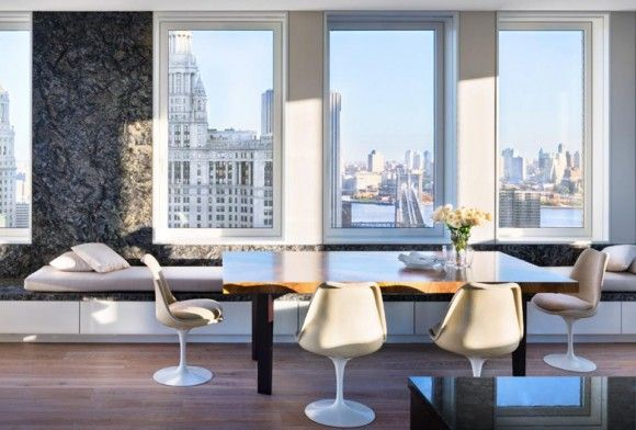 What's not to love about this: amazing view, classic Saarinen Tulip Chairs… fantastic.