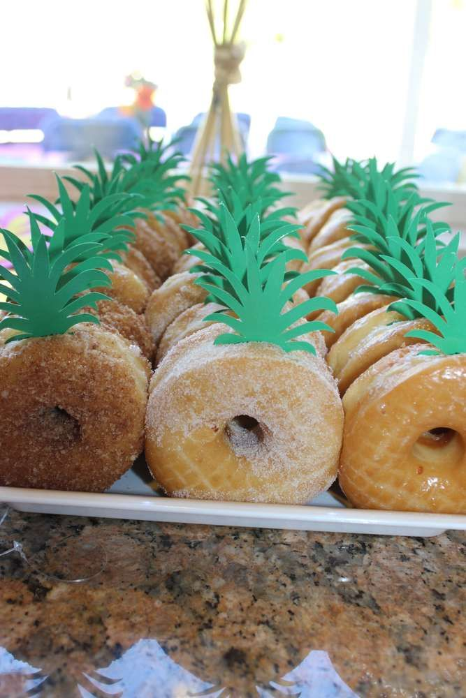 Fun donuts dressed up as pineapples for tropical party food. Makena's Hawaiian Luau | CatchMyParty.com #tropicalbirthdayparty