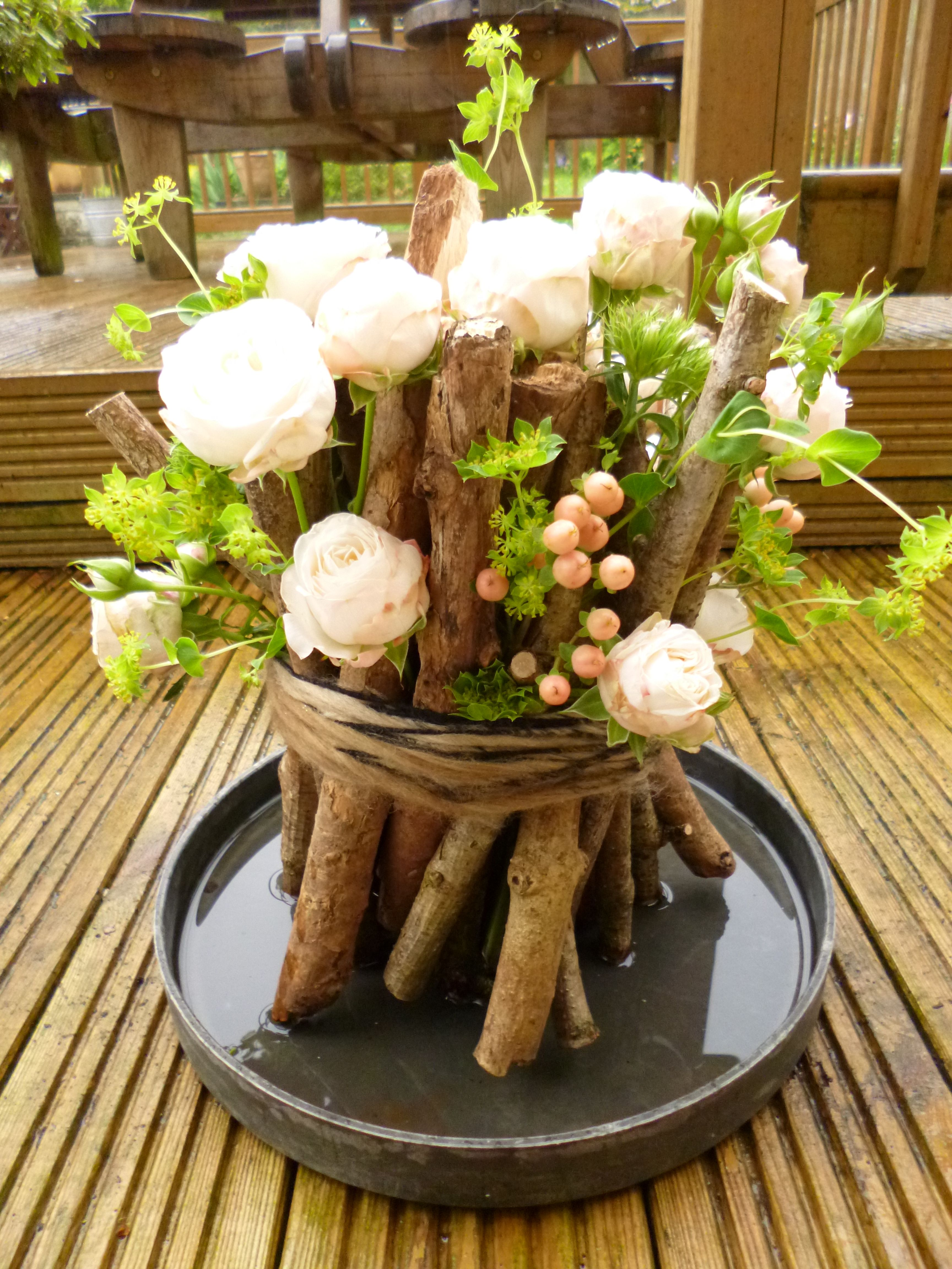 Wood wedding decoration ideas  Woodland arrangement with Bombastic roses  Art in the garden