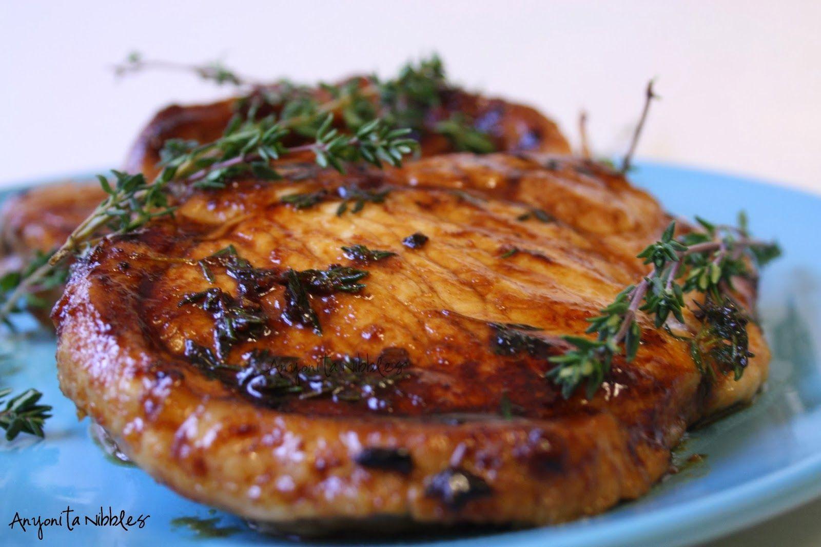 Pork chops made with honey, fresh thyme, orange juice and mustard